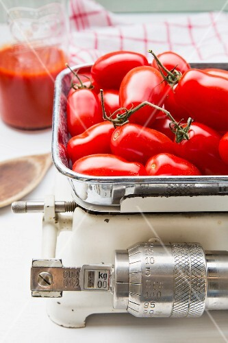 Plum tomatoes on a set of old kitchen scales