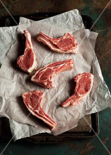 Raw lamb chops on paper