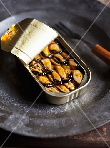 Smoked mussels in an open tin