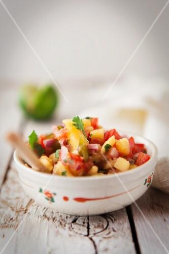 Mango salsa in a small bowl