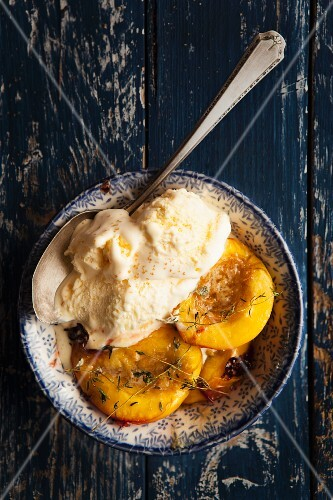 Baked nectarines with vanilla ice cream and thyme