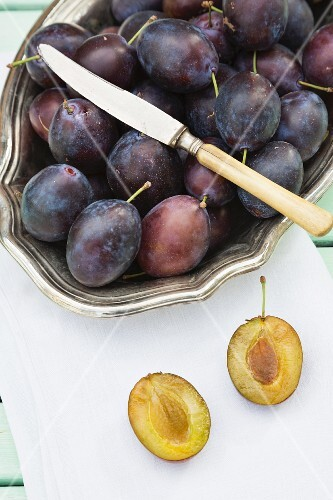 Plums in a silver bowl