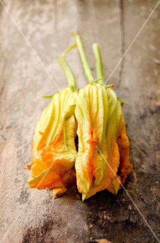Courgette flowers on an old chopping board