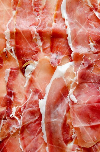 Several slices of Prosciutto from Sardinia (filling the image)