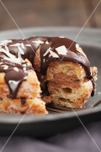A crossover between a doughnut and a croissant, with chocolate glaze