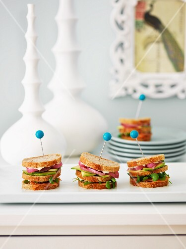 Smoked salmon, avocado and red onion sandwiches