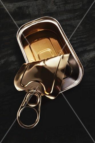 An open, empty sardine tin