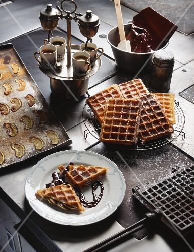 Waffles with chocolate sauce and coffee