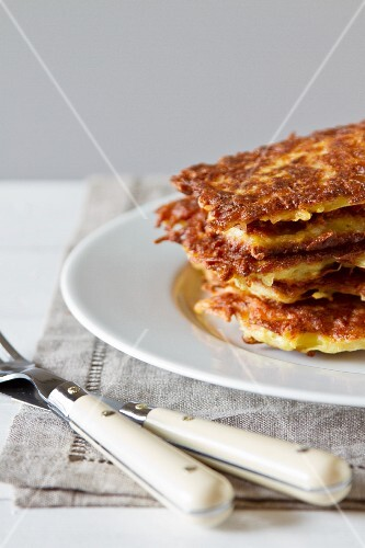 Crispy potato fritters and cutlery