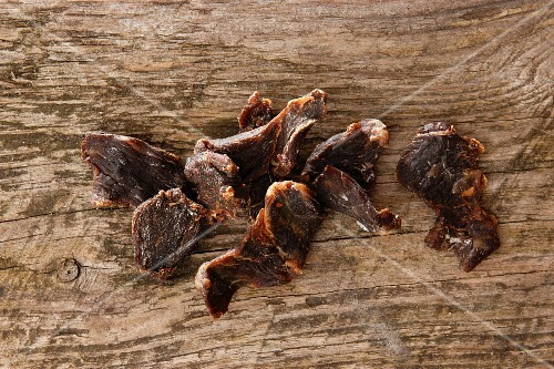 Dried beef on a wooden surface