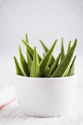 Several okra pods in a bowl