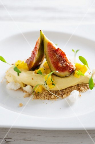A quenelle of yoghurt with figs and mango