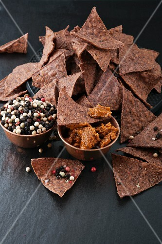 Tortilla chips with dip and peppercorns