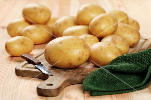 White Elfe potatoes on a chopping board