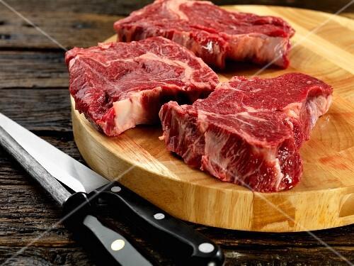 Rib eye steak on chopping board