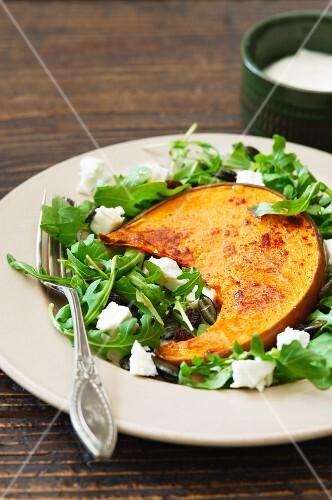 Baked squash on rocket salad with feta
