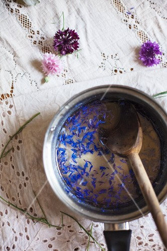 Stirring Ingredients for a Cornflower Gin Cocktail in a pot