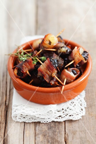 Prunes filled with apple purée and wrapped in pancetta