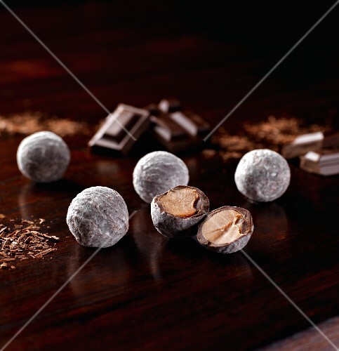 Several champagne truffles, whole and halved