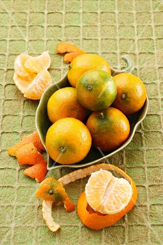 Mandarins in a leaf-shaped bowl
