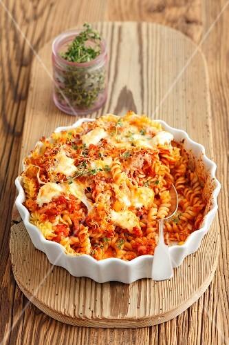 Pasta bake with tomatoes, mozzarella and parmesan