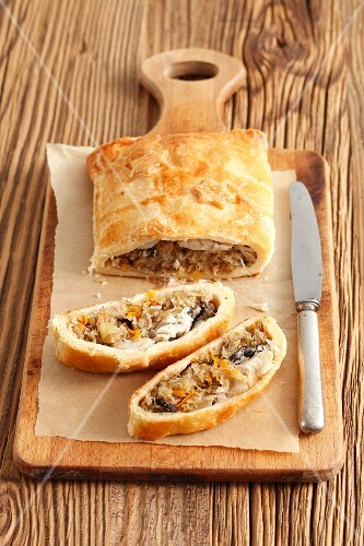Puff pastry pasty filled with sauerkraut and fish