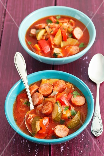 Sausage stew with peppers, tomatoes and courgette