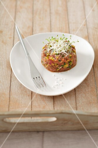 Duck tartare with edible shoots