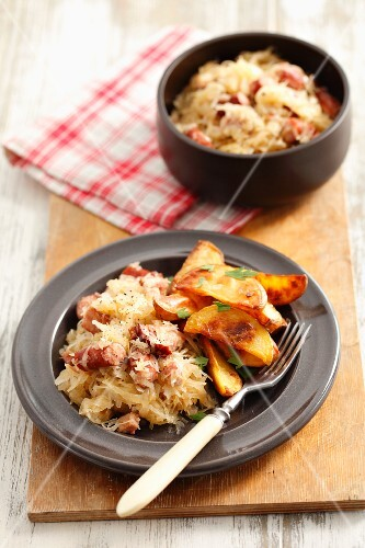 Sauerkraut with sausage and potato wedges