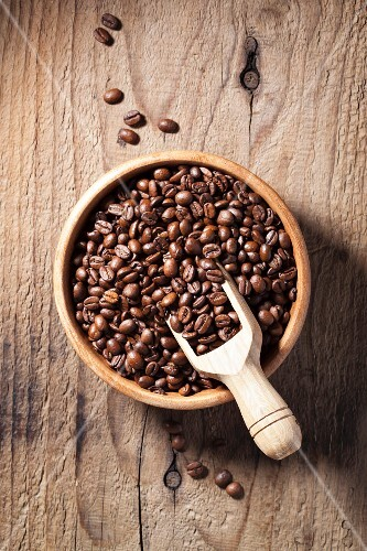 Coffee beans in a wooden bowl (view from above)