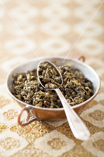 Dried oolong tea in a small bowl