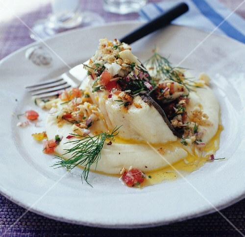 Fish fillet with tomato salsa and dill on mashed potato