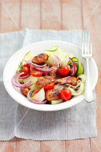 Courgette & onion salad with glazed chicken breast and cherry tomatoes