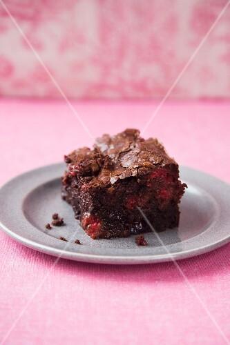 Brownie with raspberries and cranberries