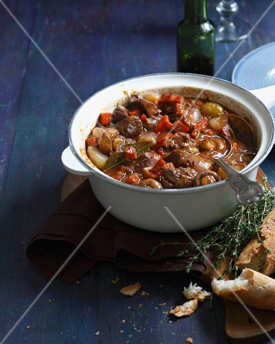 Beef daube in casserole dish with baguette
