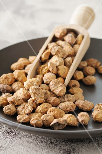 Tiger nuts on a plate with a scoop