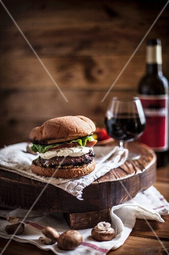 A Goat Cheese Burger with a Glass of Wine