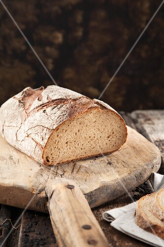 Homemade round Loaf of Bread; Partially Sliced
