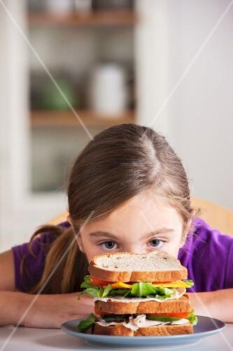 Girl staring at sandwich