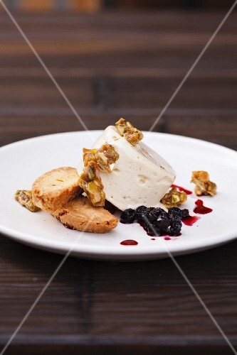 Pistachio Ice Cream with Pistachio Brittle, Currant Sauce and Biscotti