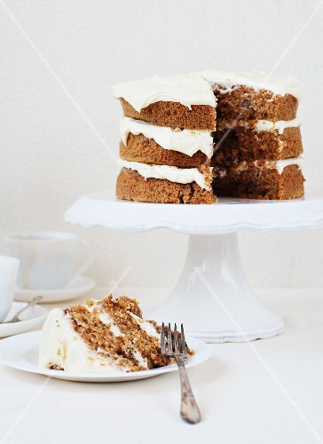 Carrot cake with cream cheese frosting, one slice served