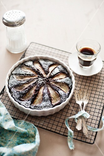 Chocolate and pear tart and a cup of coffee