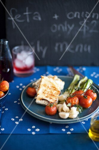 Fried feta with spring onions and tomatoes