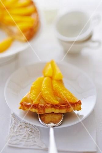 A slice of orange tart on a cake slice