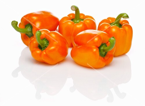 Five orange peppers