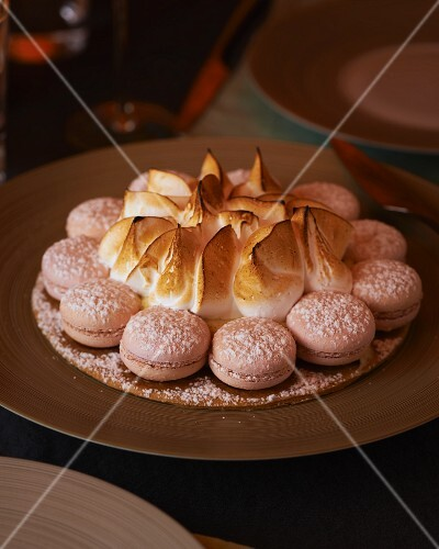 Gateau Saint Honoré with meringue and macaroons (France)