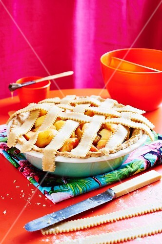 Peach pie in a pie dish