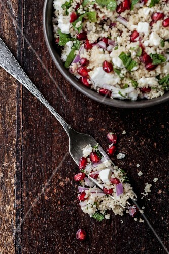 Couscous salad with pomegranate seeds, feta and mint