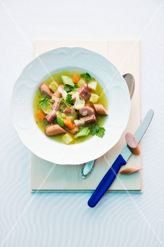 Pea stew with sausage, vegetables and bacon