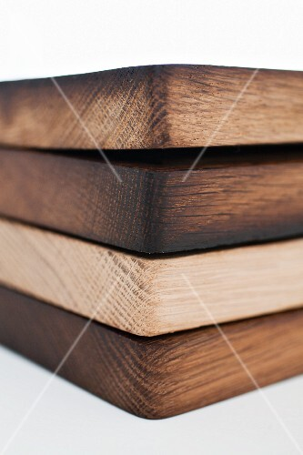 Four wooden chopping boards, stacked (section)